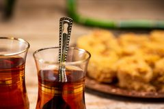 Arabic tea with desserts closeup. Arabic tea with desserts on a table close up glass cube piece food kadayif cuisine cup delicious sweet snack drink candy stock photo