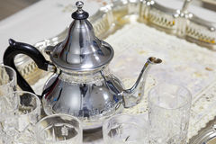 Arabic tea. Metal teapot with glasses. Arabic tea theme. Metal teapot with glasses Stock Photo