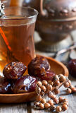 Arabic tea, rosary and dates Stock Photo