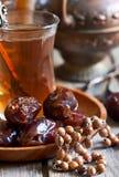 Arabic tea, rosary and dates Stock Photo
