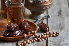 Arabic tea, rosary and dates Stock Photography