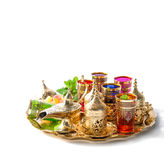 Arabic tea service golden cups Holidays decoration white backgro Stock Photo