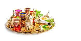 Arabic tea serviceHolidays decoration white background. Arabic tea service. Ramadan kareem. Holidays decoration on white background. Vibrant colors Royalty Free Stock Image