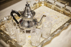 Arabic tea. Teapot with glasses on metal salver. Arabic tea theme. Teapot with glasses on metal salver Stock Photography