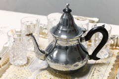 Arabic tea theme. Metal teapot with glasses Royalty Free Stock Photography