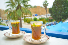 The arabic tea. The traditional Tunisian tea with the fresh mint and pine nuts, Hammamet Royalty Free Stock Photos