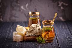 Arabic tea with turkish delight and halva. Selective focus Royalty Free Stock Image