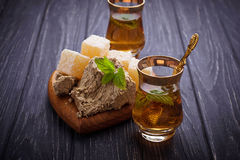 Arabic tea with turkish delight and halva. Selective focus Royalty Free Stock Photo