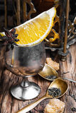 Arabic tea on wood background. Tea with lemon and spice on the retro wooden background Stock Image
