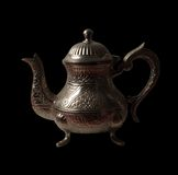 Arabic teapot. With shades over black background Royalty Free Stock Photography