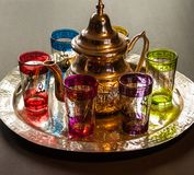 Arabic teapot with colorful glasses.  Royalty Free Stock Images