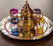 Arabic teapot with colorful glasses.  Stock Images