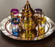 Arabic teapot with colorful glasses.  Royalty Free Stock Photo