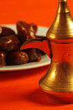 Arabic teapot and dates. In the background Stock Images