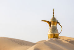 Arabic teapot. On a desert dune Royalty Free Stock Photography