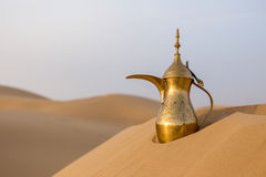 Arabic teapot. On a desert dune Royalty Free Stock Images