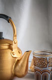 Arabic teapot on white wooden table Royalty Free Stock Images