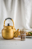Arabic teapot on white wooden table Royalty Free Stock Photo