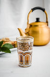 Arabic teapot on white wooden table Stock Photo