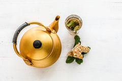 Arabic teapot on white wooden table Stock Photos