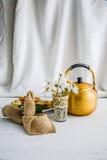 Arabic teapot on white wooden table. Arabian golden teapot on white wooden table Stock Photos