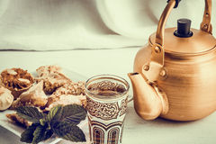 Arabic teapot on white wooden table Royalty Free Stock Photos