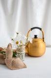 Arabic teapot on white wooden table. Arabian golden teapot on white wooden table Stock Photography