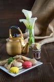 Arabic teapot on white wooden table. Arabian golden teapot on white wooden table Royalty Free Stock Photos