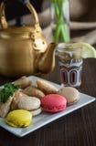 Arabic teapot on white wooden table. Arabian golden teapot on white wooden table Royalty Free Stock Photography