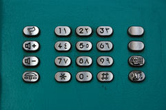 Arabic telephone. Push buttons on a public telephone in Egypt with both western and arabic numerals Stock Photo