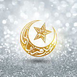 Arabic text for Eid-Al-Adha celebration. Arabic Islamic calligraphy of text Eid-E-Qurba and Eid-Al-Adha in golden crescent moon and star shape on silver glitter Stock Photos
