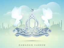 Arabic text with pigeon for Ramadan Kareem celebration. Stock Photo