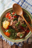 Arabic thick lamb soup with vegetables closeup. vertical top vie. Arabic thick lamb soup with vegetables closeup at the plate on the table. Vertical view from Royalty Free Stock Photos