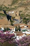 Arabic tower and rooftops, Antequera, Spain. Arabic tower with pink blossom trees in the foreground, Antequera, Malaga Province, Andalucia, Spain, Western Stock Images