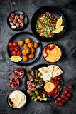 Arabic traditional cuisine. Middle Eastern meze platter with pita, olives, hummus, stuffed dolma, labneh cheese balls, falafel. stock image