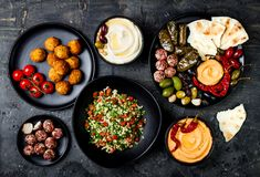 Arabic traditional cuisine. Middle Eastern meze platter with pita, olives, hummus, stuffed dolma, labneh cheese balls, falafel. Arabic traditional cuisine royalty free stock photos
