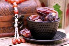 Arabic traditional dishes, pots and dates fruits. Holidays decoration. Ramadan Kareem. Arabic traditional dishes, pots and special dates fruits. Holidays Stock Photo