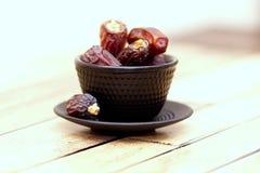 Arabic traditional dishes, pots and dates fruits. Holidays decoration. Ramadan Kareem. Arabic traditional dishes, pots and special dates fruits. Holidays Royalty Free Stock Image