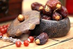 Arabic traditional dishes, pots and dates fruits. Holidays decoration. Ramadan Kareem. Arabic traditional dishes, pots and special dates fruits. Holidays Royalty Free Stock Photo