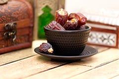 Arabic traditional dishes, pots and dates fruits. Holidays decoration. Ramadan Kareem. Arabic traditional dishes, pots and special dates fruits. Holidays Stock Photography