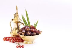 Arabic traditional dishes, pots and dates fruits. Holidays decoration. Ramadan Kareem. Arabic traditional dishes, pots and special dates fruits. Holidays Stock Photos