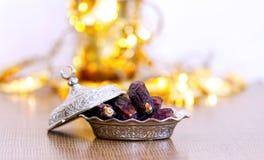 Arabic traditional dishes, pots and dates fruits. Holidays decoration. Ramadan Kareem. Arabic traditional dishes, pots and special dates fruits. Holidays Royalty Free Stock Photography