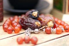 Arabic traditional dishes, pots and dates fruits. Holidays decoration. Ramadan Kareem. Arabic traditional dishes, pots and special dates fruits. Holidays Stock Images
