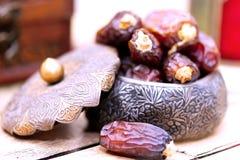 Arabic traditional dishes, pots and dates fruits. Holidays decoration. Ramadan Kareem. Arabic traditional dishes, pots and special dates fruits. Holidays Stock Image