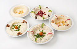 Arabic traditional Hummus Plates. With different toppings  on white Royalty Free Stock Photography