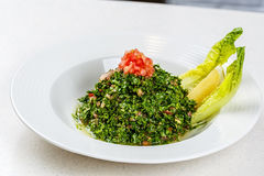 Arabic traditional salad Tabbouleh. With Fresh Parsley, Tomatoes, Cracked Wheat, Onions, Freshly Squeezed Lemon Juice Virgin Olive Oil Stock Images