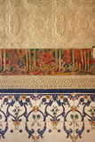Arabic Wall. A colorful Arabian wall in Granada, Spain with Arabic writing traditional colors with tiles (azulejo) and stucco (yeseria Stock Photos