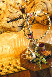 Arabic water pipe with tea set Royalty Free Stock Images