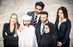 Arabic and western business people. Portrait. Motivational concept Stock Image