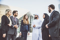 Arabic and western business people. Speaking about investments Royalty Free Stock Images